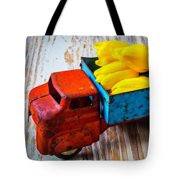 Tulips In Toy Truck Tote Bag by Garry Gay