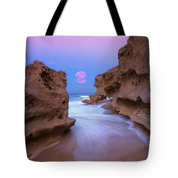 Tote Bag featuring the photograph Twilight Moon Rising Over Hutchinson Island Beach Rocks by Justin Kelefas