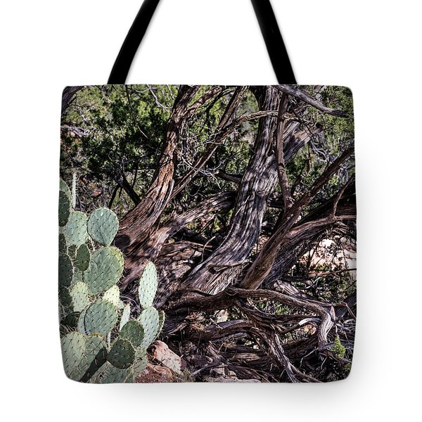 Tote Bag featuring the photograph Twisted by John Gilbert