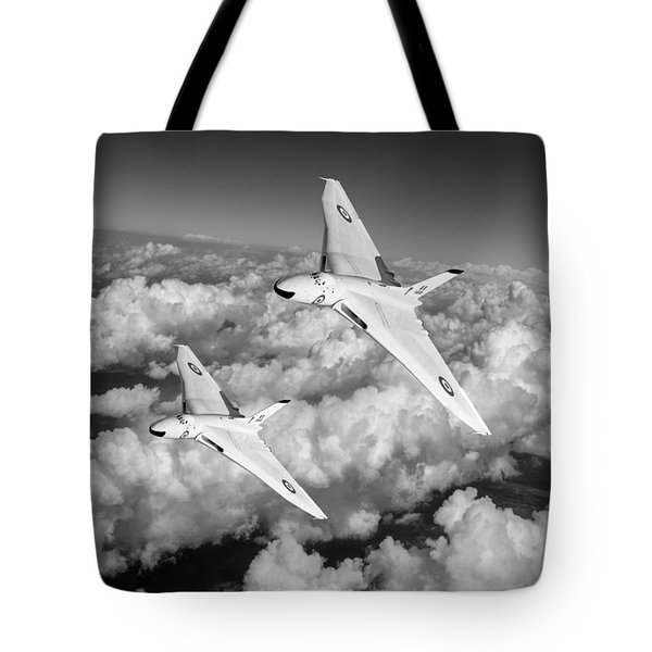 Tote Bag featuring the photograph Two Avro Vulcan B1 Nuclear Bombers Bw Version by Gary Eason