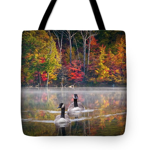 Two Canadian Geese Swimming In Autumn Tote Bag