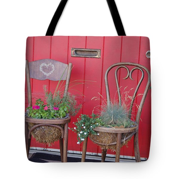 Tote Bag featuring the photograph Two Chairs With Plants by Frank Stallone
