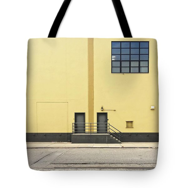 Two Doors In Yellow Wall Tote Bag