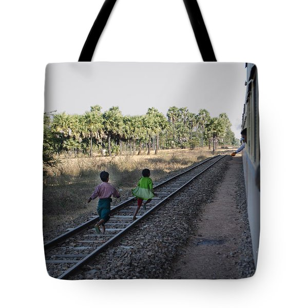 Two Kids Run Along And Follow Train In Burma Tote Bag by Jason Rosette