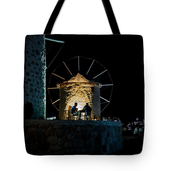 Two Men Eating By The Alacati Windmills Tote Bag