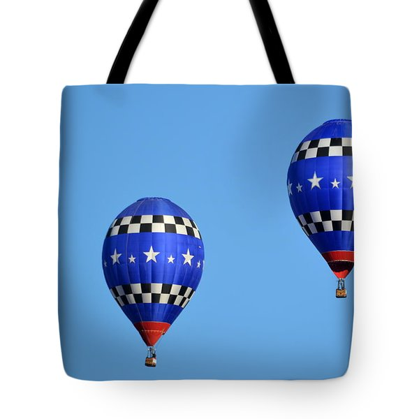 Tote Bag featuring the photograph Two Of A Kind by AJ Schibig