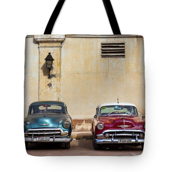 Tote Bag featuring the photograph Two Old Vintage Chevys Havana Cuba by Charles Harden