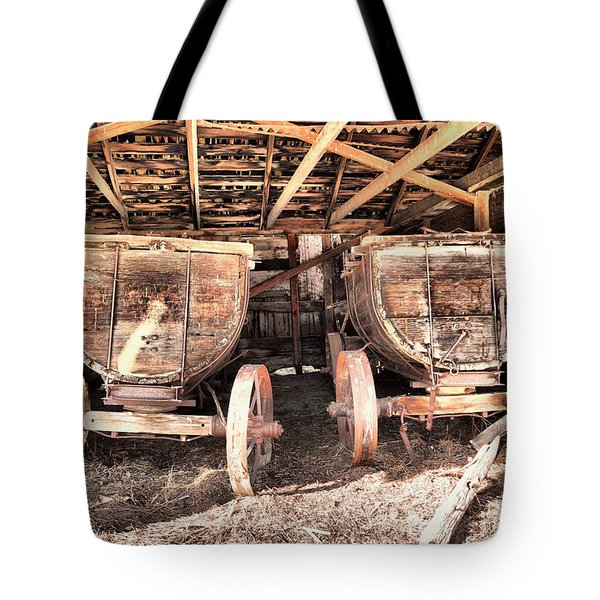 Tote Bag featuring the photograph Two Old Wagons by Jeff Swan
