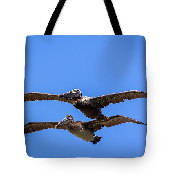 Two Pelicans Over The Beach Tote Bag