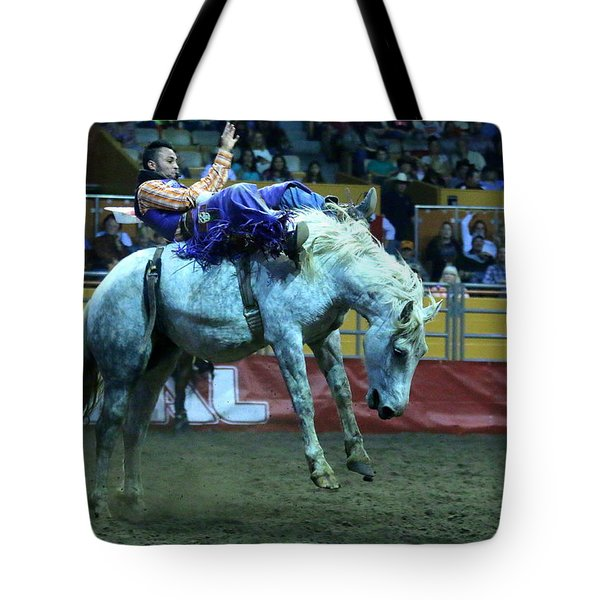 Tote Bag featuring the photograph Two Seconds Later At The Grand National Rodeo by John King