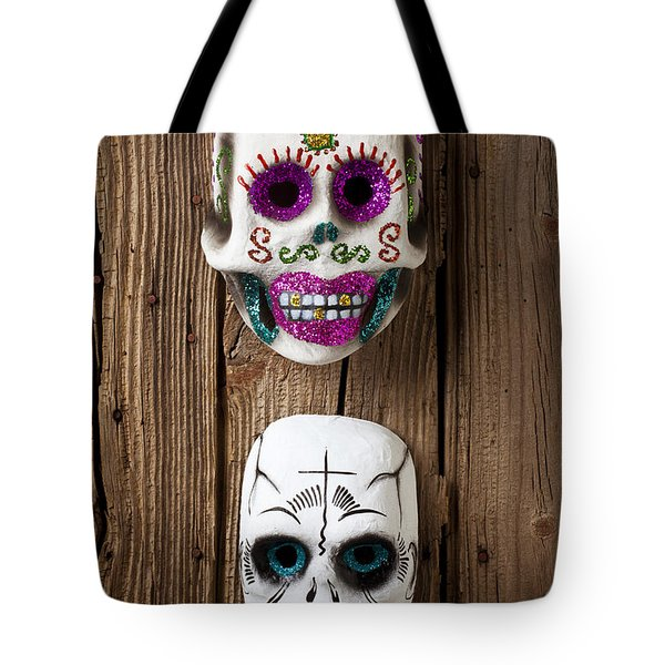 Two Skull Masks Tote Bag by Garry Gay