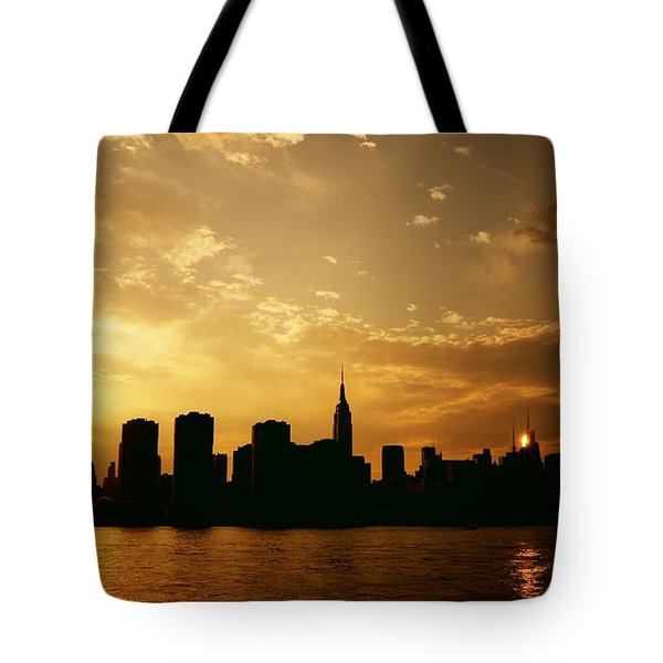 Two Suns - The New York City Skyline In Silhouette At Sunset Tote Bag by Vivienne Gucwa