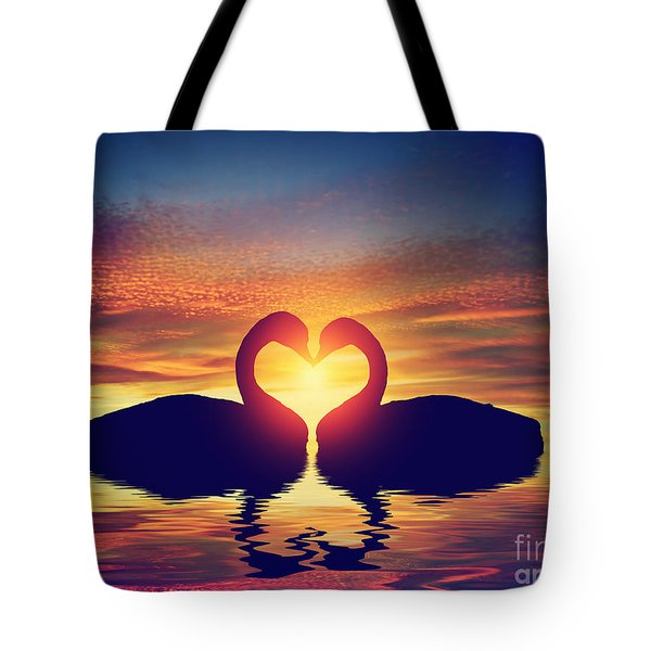 Two Swans Making A Heart Shape At Sunset. Valentine's Day Tote Bag