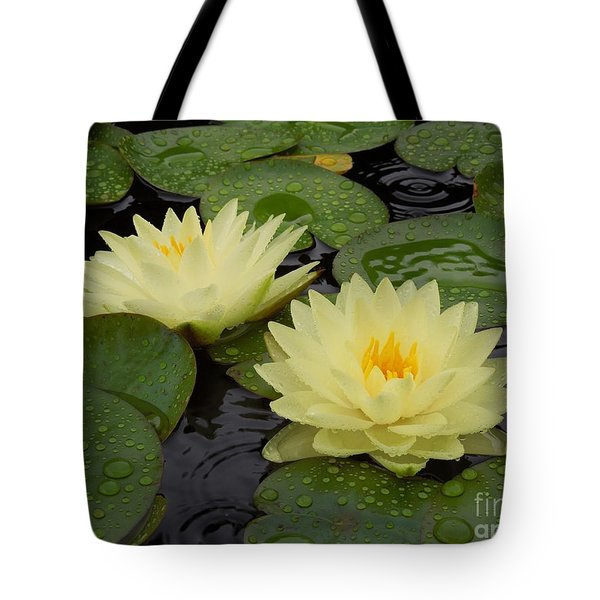 Two Water Lilies In The Rain Tote Bag