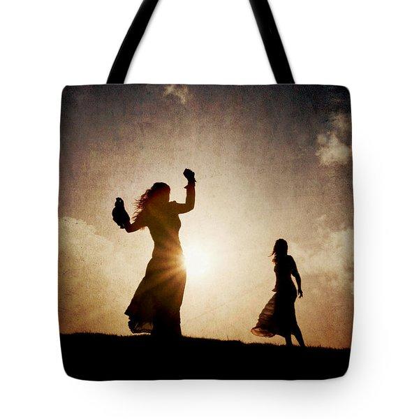 Two Women Dancing At Sunset Tote Bag