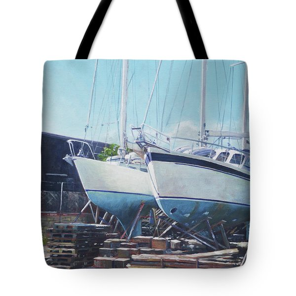 Tote Bag featuring the painting Two Yachts Receiving Maintenance In A Yard by Martin Davey