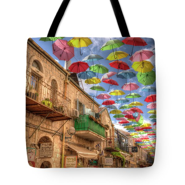 Tote Bag featuring the photograph Umbrellas Over Jerusalem by Uri Baruch