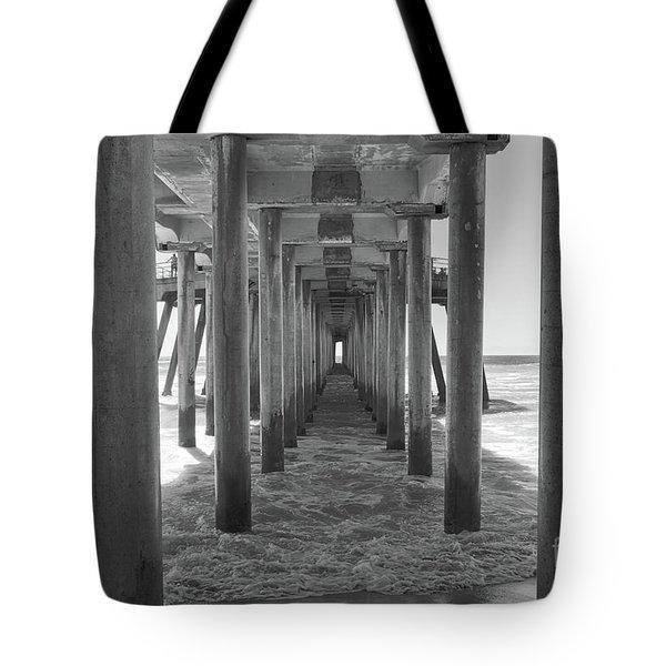 Tote Bag featuring the photograph Under Huntington Beach Pier by Ana V Ramirez