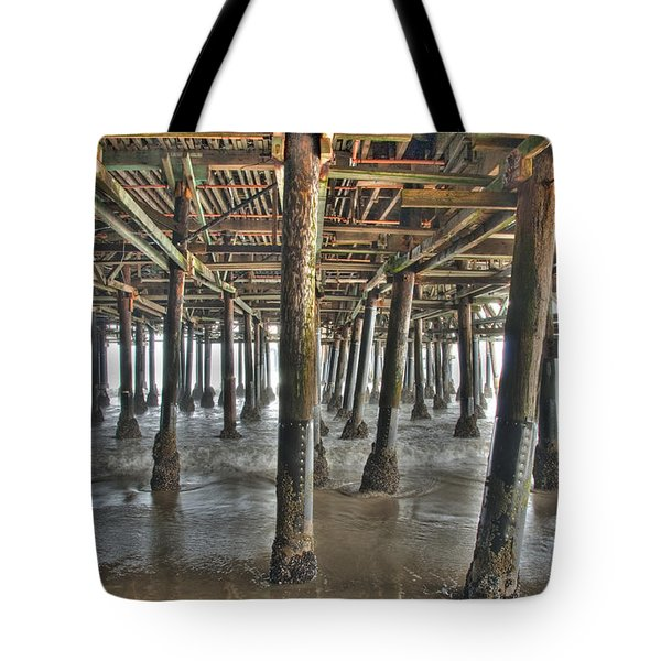 Tote Bag featuring the photograph Under The Boardwalk Pier Sunbeams  by David Zanzinger