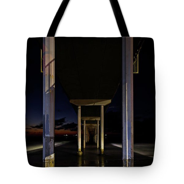 Tote Bag featuring the photograph Under The Ocean Beach Pier At Sunste by James Sage