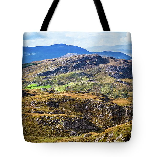 Tote Bag featuring the photograph Undulating Green, Purple And Yellow Rocky Landscape In  Ireland by Semmick Photo
