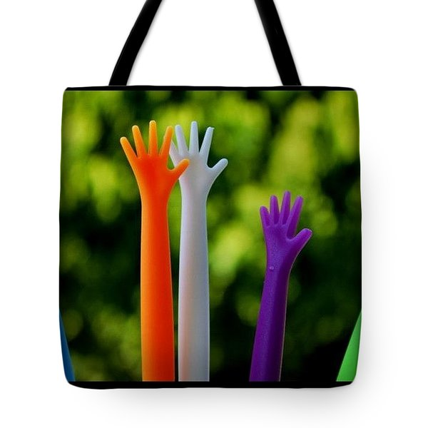 Tote Bag featuring the photograph United  Colours by Marija Djedovic