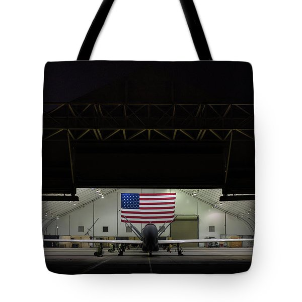 Us Air Force Eq 4 Global Hawk Assigned To The 380th Air Expeditionary Wing Await Routine Maintenance Tote Bag