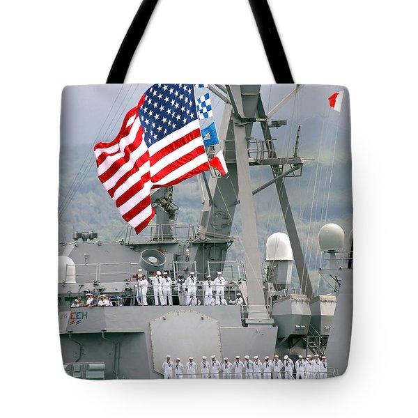 U.s. Navy Sailors Line The Rails Aboard Tote Bag