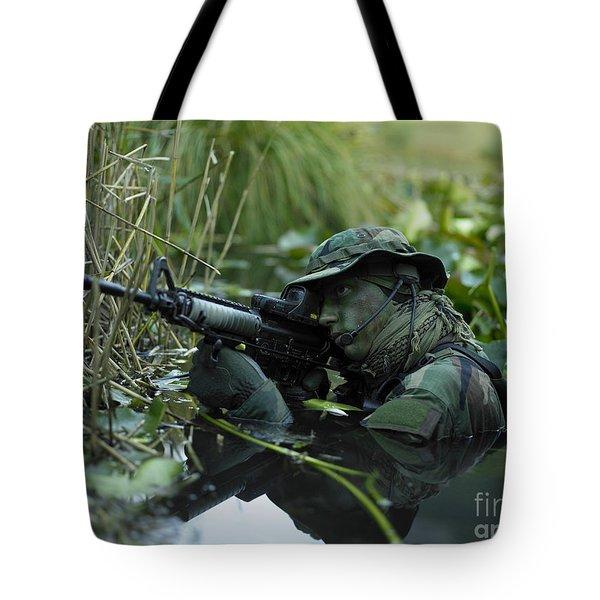 U.s. Navy Seal Crosses Through A Stream Tote Bag