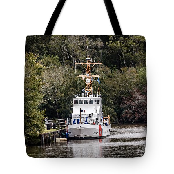 Tote Bag featuring the photograph Uscgc Pelican Moored 1 by Gregory Daley  PPSA