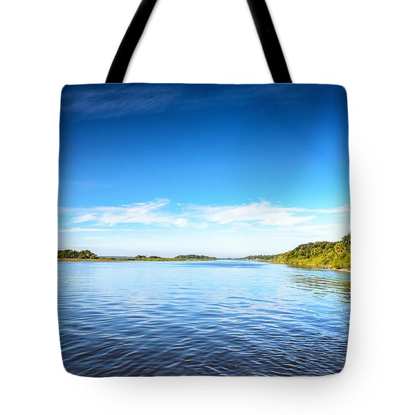 Tote Bag featuring the photograph River Blue by Claire Turner