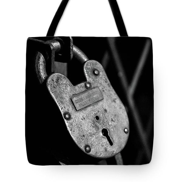 Tote Bag featuring the photograph Very Secure by Doug Camara