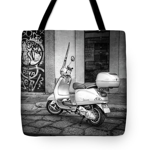 Tote Bag featuring the photograph Vespa Scooter In Milan Italy In Black And White  by Carol Japp