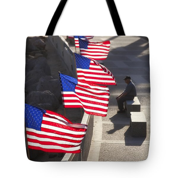 Tote Bag featuring the photograph Veteran With United States Flags by John A Rodriguez