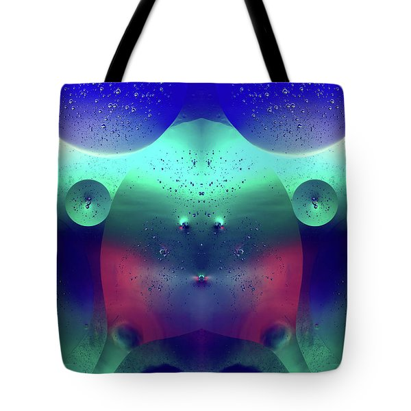 Tote Bag featuring the photograph Vibrant Symmetry Oil Droplets by John Williams
