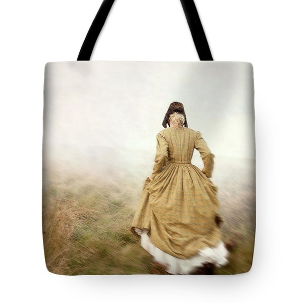 Victorian Woman Running On The Misty Moors Tote Bag