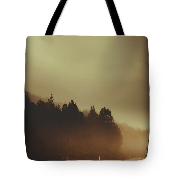 View Of Abandoned Country Road In Foggy Forest Tote Bag
