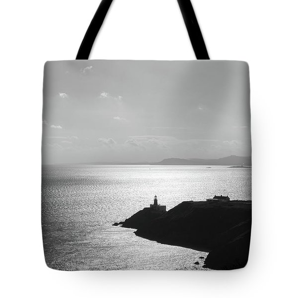 Tote Bag featuring the photograph View Of Howth Head With The Baily Lighthouse In Black And White by Semmick Photo