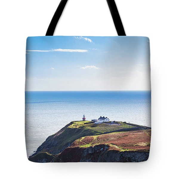 Tote Bag featuring the photograph View Of The Trails On Howth Cliffs With The Lighthouse In Irelan by Semmick Photo