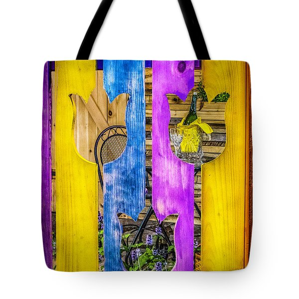 Tote Bag featuring the photograph View Thru The Fence by Nick Zelinsky