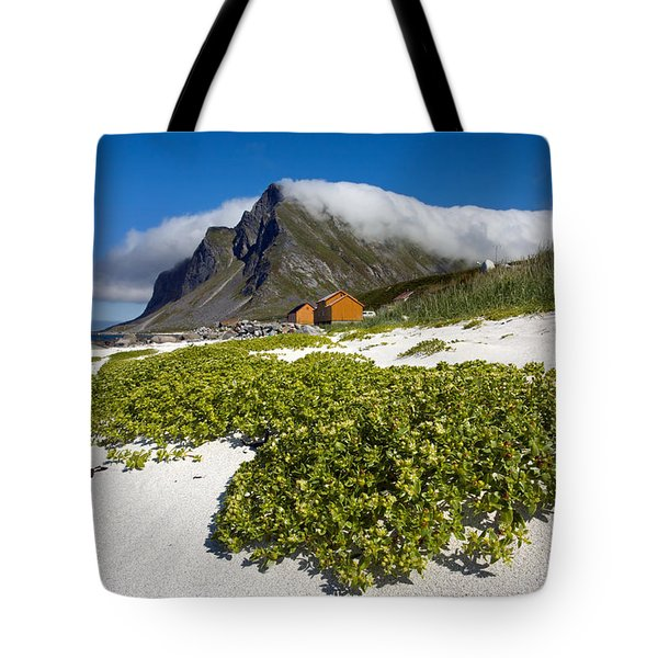 Vikten Beach With Green Grass And Clouds Tote Bag by Aivar Mikko