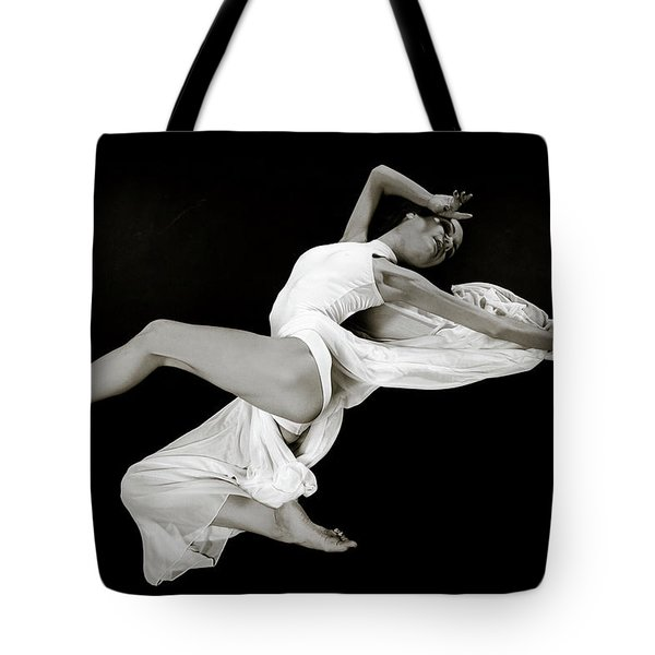 Tote Bag featuring the photograph Viktory On Black by Rikk Flohr