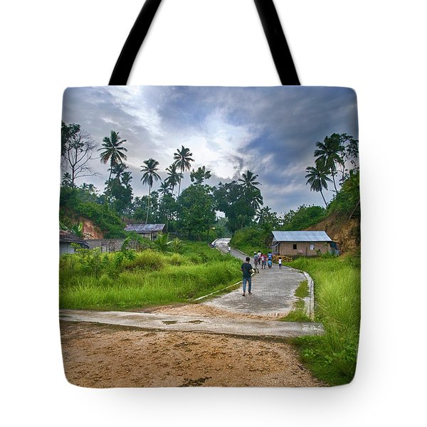 Tote Bag featuring the photograph Village Scene by Charuhas Images