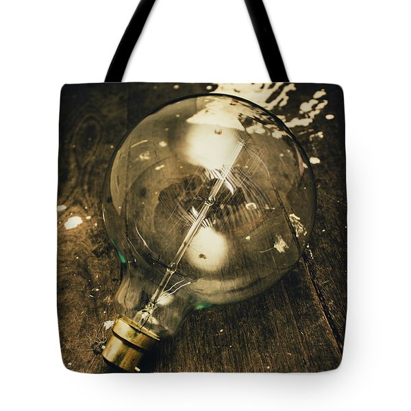 Vintage Light Bulb On Wooden Table Tote Bag by Jorgo Photography - Wall Art Gallery