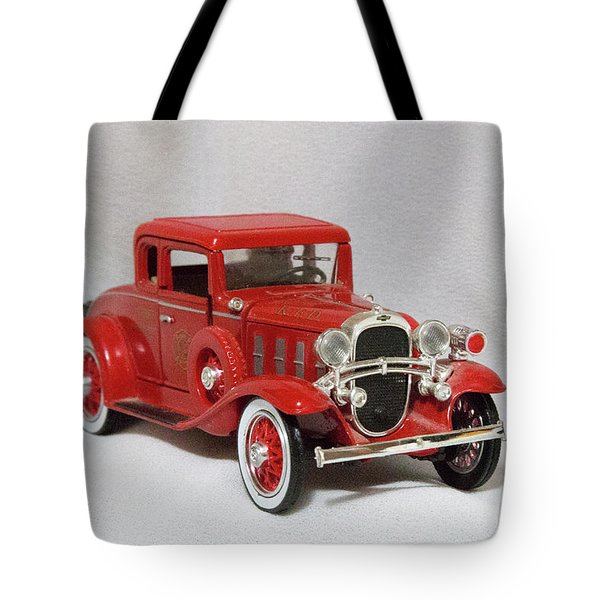 Tote Bag featuring the photograph Vintage Model Fire Chiefcar by Linda Phelps