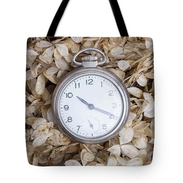 Tote Bag featuring the photograph Vintage Pocket Watch Over Dried Flowers by Edward Fielding