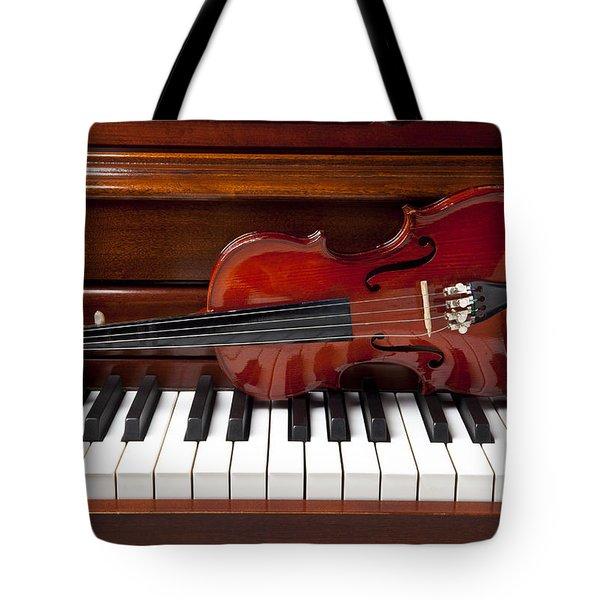 Violin On Piano Tote Bag