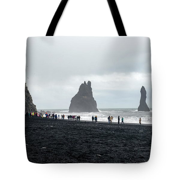 Tote Bag featuring the photograph Visitors In Reynisfjara Black Sand Beach, Iceland by Dubi Roman