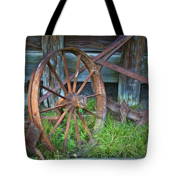 Tote Bag featuring the photograph Wagon Wheel And Fence by David and Carol Kelly