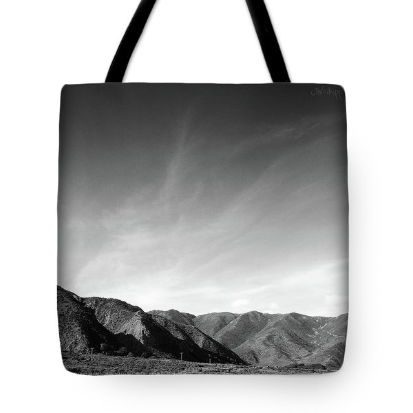 Tote Bag featuring the photograph Wainui Hills Squared In Black And White by Joseph Westrupp